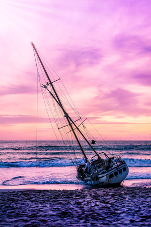 Boat on the beach in twilight and colorful of sunset, Seascape landscape nature