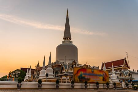 Pagoda in temple and color of sky sunset or sunrise in twilight, Public in Thailand, Nakhon si thammarat province Stock Photo