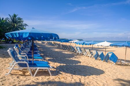 Beach with umbrella and white sand and blue sea and blue sky and white cloud sunny in holiday summer season