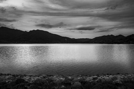 View of landscape nature and river with mountain and sunlight in twilight, Black and white and monochrome style