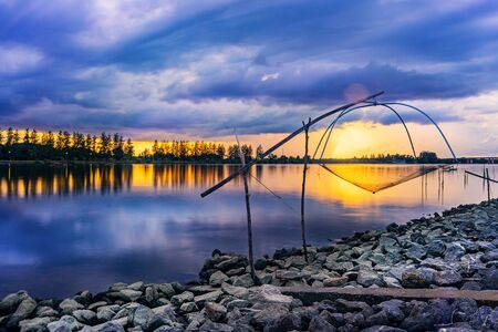 Sea sunset or sunrise with fishing tool countryside and colorful of sky and cloud with sunlight in twilight Imagens