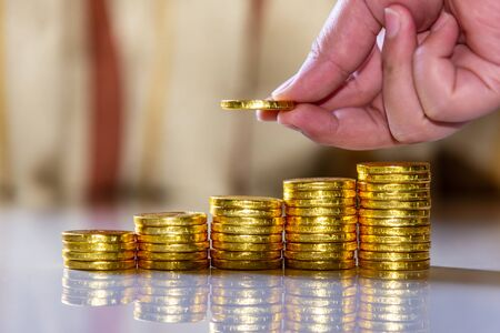 Save money and account banking for finance business concept, Hand with coin money on blurred background Imagens