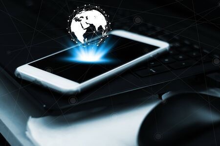 Networking and internet connection concept, Smart phone mobile on computer keyboard with copy space dark filter background