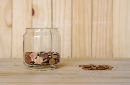 Save money and account banking for finance business concept, Coin money on blurred wooden background Imagens