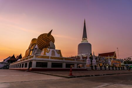 Temple with pagoda and buddha statue and color of sky sunset or sunrise in twilight, Public in Thailand, Nakhon si thammarat province