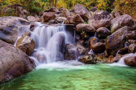 River stone and waterfall, View water river tree, Stone river in multi color tree leaf in forest Фото со стока - 131363589
