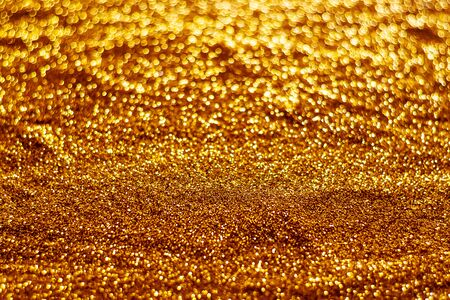 Glitter light abstract gold bokeh christmas light blurred background