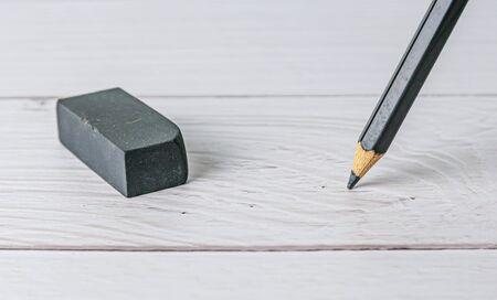 Eraser and error concept, Eraser and pencil on white table, Mistake erase concept Stok Fotoğraf