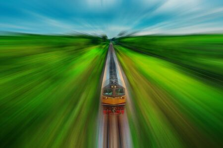 Train on railway transportation in forest and color of sunset and cloud storm blurred style, Transportation concept