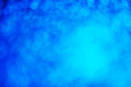 Glitter light abstract blue bokeh light blurred background Stock fotó