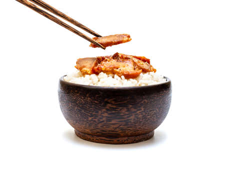 White rice with grilled pork and chopsticks in black bowl on white background, Rice from asia, Rice food of asian style