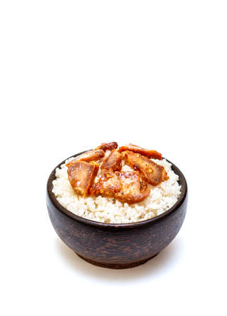 White rice with grilled pork in black bowl on white background, Rice from asia, Rice food of asian style Standard-Bild