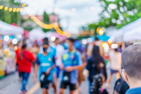 Abstract blur, people walking on street in food festival with light bokeh, Blurred for background design