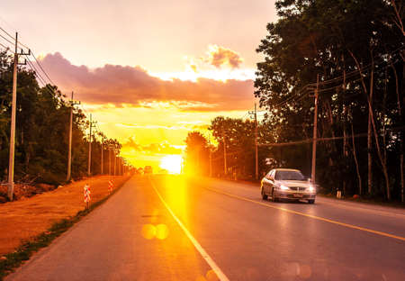 Pattalung, Thailand - August 29, 2020 : Road with car and colorful of sunset or sunrise in twilight