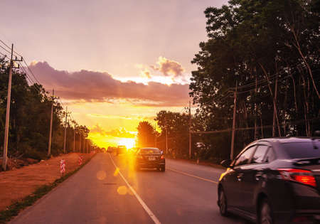 Pattalung, Thailand - August 29, 2020 : Car on road with colorful of sunset or sunrise in twilight Editorial