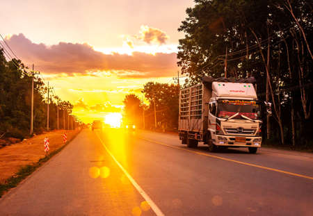 Pattalung, Thailand - August 29, 2020 : Truck on road with colorful of sunset or sunrise in twilight