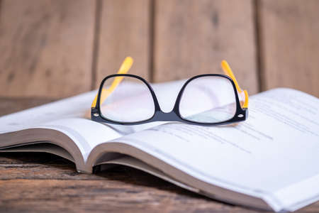 Read and knowledge concept, Glasses on the book blurred background, Selective focus