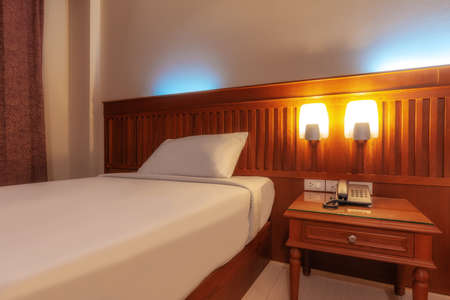 Happy bedroom and comfortable mattress and pillows over light at window, Room and interior concept Banque d'images