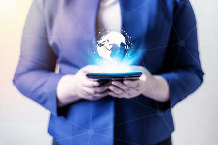 Technology people global connection network concept, Business women with laptop and virtual earth blurred background Banque d'images