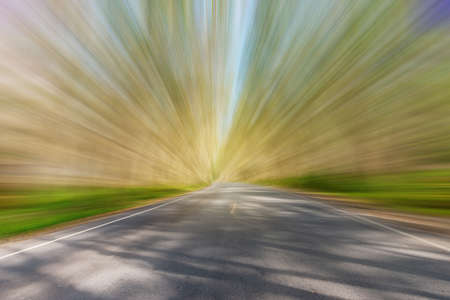 Tree tunnel, Asphalt road blurred, green leaf, of tree tunnel, sky background, Abstract road background Stock fotó