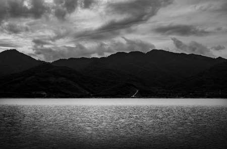 View of landscape nature and river and mountain in evening light, Black and white and monochrome style