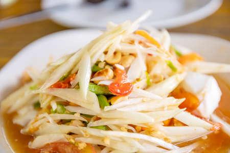 Papaya salad or Som tam in Thai street food blurred background