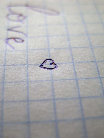 corazon: Heart on a sheet on notebook