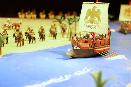 navigating: Egyptian ship navigating a river with horses, playmobil Stock Photo