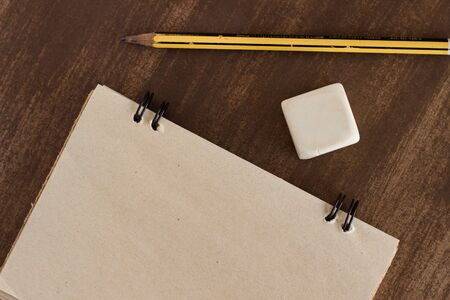 old notebook for aiming with pen on wooden table