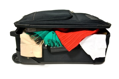 an overstuffed suitcase on a white background photo