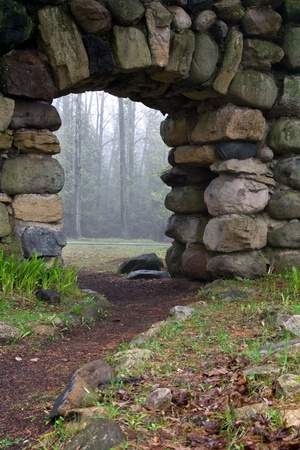 archway through a stone wall with a path leading to it Stock Photo - 9529230