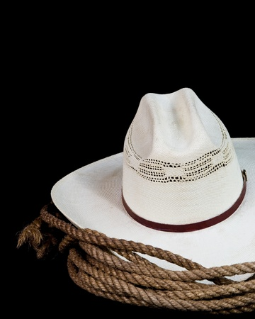 rodeo cowboy: a cowboy hat and lasso on a black background Stock Photo