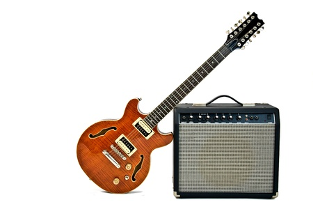 guitar amplifier: electric guitar leaning on a small amplifier