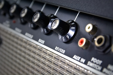 closeup of amplifier controls with reverb knob highlighted Stock Photo - 9783768