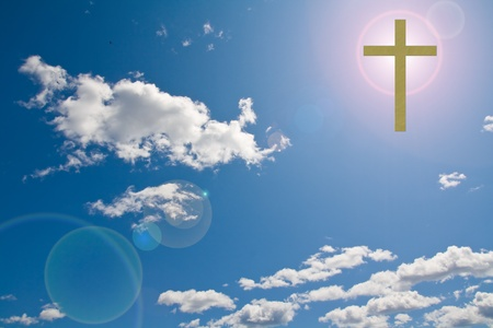 christian faith: a Christian cross in a clouded sky with sun flare behind it