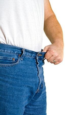 Man holds out waistline with pride after loosing a few pounds photo