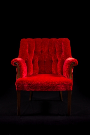 red chair: a red velvet chair