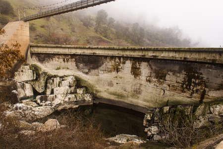 Face of small concrete dam