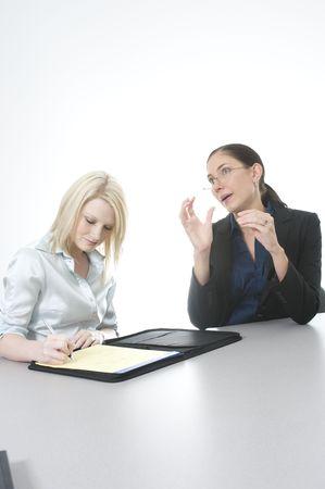 female boss explains the issue to her secretary