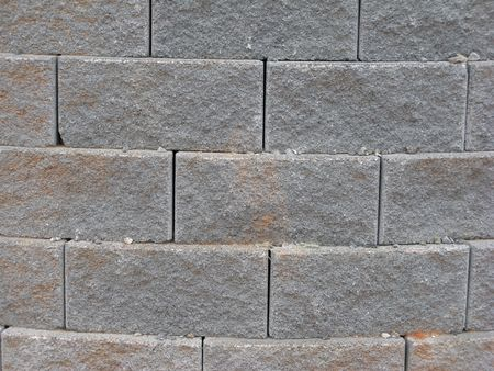 concave: pattern of texture of a masonry block wall