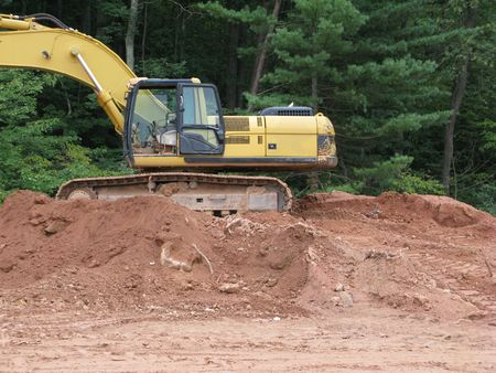 earthwork: earthmoving equipment in various stages of project