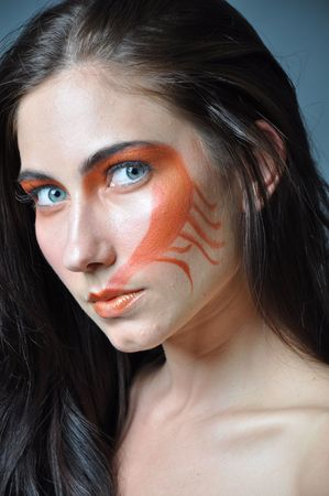 various images of a fashion model with a painted face photo