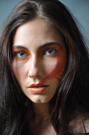 various images of a fashion model with a painted face
