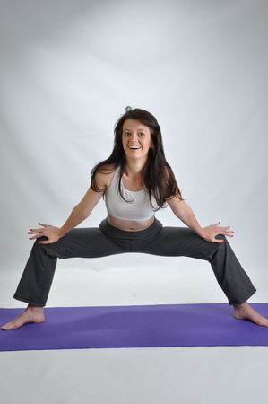 a young brunette woman doing various yoga poses Stock Photo