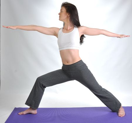 yoga pants: a young brunette woman doing various yoga poses Stock Photo
