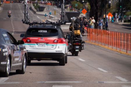 Denver, Colorado, USA - August 26, 2012 - Neutral Support Vehicles and Radio Shack team car following rider during the 2012 USA Pro Cycling Challenge Stage 7 time trial