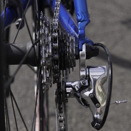 Closeup of rear cassette of road bike including rear derailleur