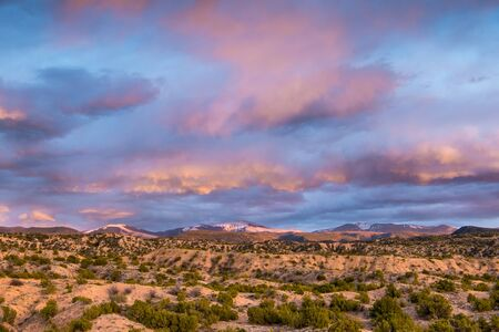 Beautiful, colorful sunset over the Sangre de Cristo Mountains and desert near Santa Fe, New Mexico