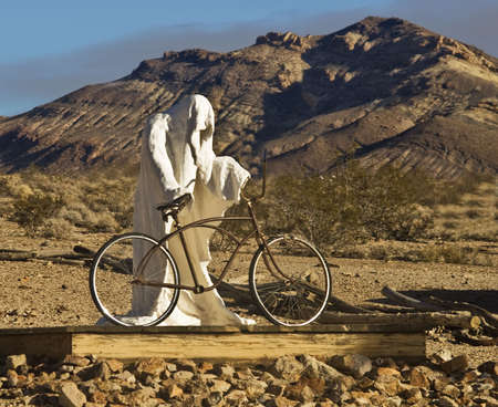 Ghost mounting a bike