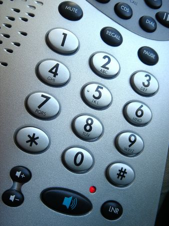 Telephone keypad with speaker and volume buttons plus lit LED indicator